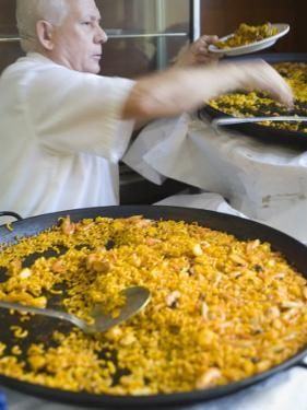 Man Serving Paella, with Noodle Paella in Foreground, Central, Valencia, Spain by Greg Elms