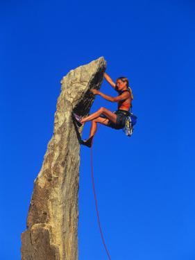 Female Rock Climber by Greg Epperson