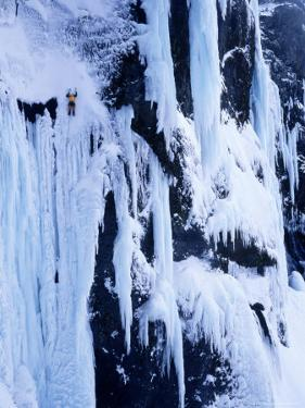 Man Ice Climbing Rammstein, Baejargil, Iceland by Greg Epperson