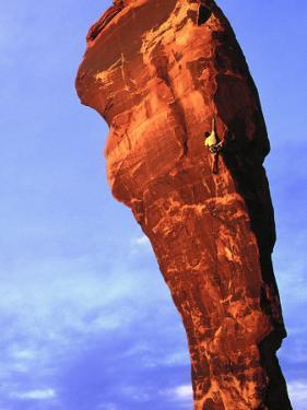 Man Rock Climbing, Canyonlands, UT by Greg Epperson