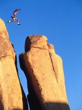 Person Jumping from Peak to Peak by Greg Epperson