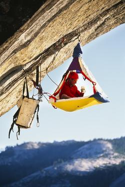 Rock Climber Bivouacked in His Portaledge on an Overhanging Cliff. by Greg Epperson