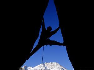 Silhouette of Man Rock Climbing on Split Rock, CA by Greg Epperson