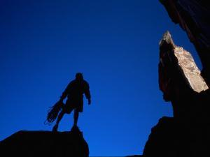 Silhouette of Rock Climber, UT by Greg Epperson