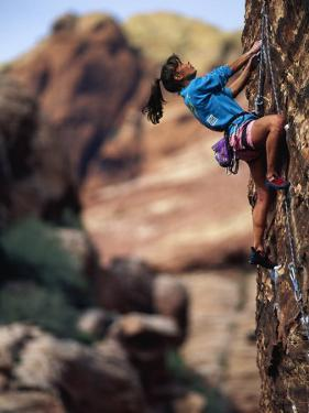 Woman Rock Climbing, CA by Greg Epperson