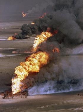 Gulf War 1991 Kuwait Burning Oil Field by Greg Gibson