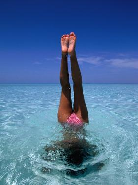 A Female Swimming in Crystal Clear Waters, Bahamas by Greg Johnston