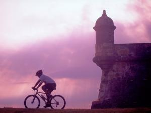 Cycling at El Morro in Old San Juan at Sunset, Puerto Rico by Greg Johnston