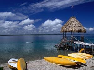 Kayaks for Rent on the Shores of Lake Peten Itza Near Tikal, El Peten, Guatemala by Greg Johnston