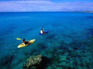 Man and Woman Kayaking on Fernandez Bay, Cat Island, Bahamas by Greg Johnston