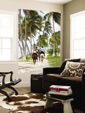 Tourists Horseback Riding Along Beach Trails by Greg Johnston
