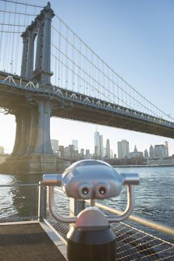 Binoculars facing the Manhattan Bridge, Brooklyn Bridge Park, New York City, New York by Greg Probst