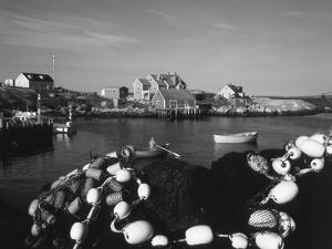Fishing Nets and Houses at Harbor, Peggy's Cove, Nova Scotia, Canada by Greg Probst