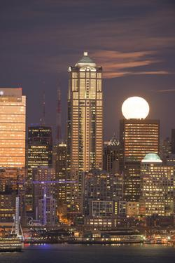 Moonrise behind the downtown Seattle skyline, Seattle, WA by Greg Probst