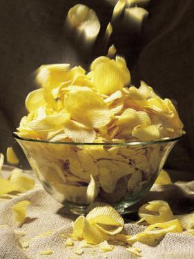 Potato Chips Falling Into Bowl by Greg Smith