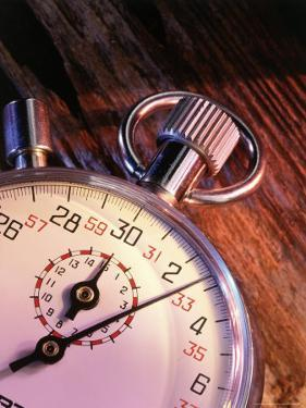 Stopwatch on Wood Background by Greg Smith