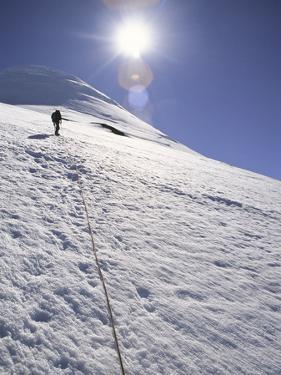 A Man Hikes Up on Mount Osorno, Chile by Greg Winston