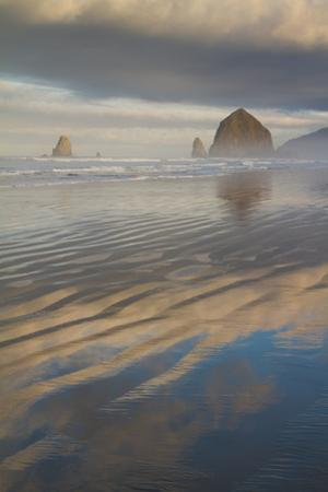 Haystack Rock, the Needles, and Reflections of Clouds at Sunrise