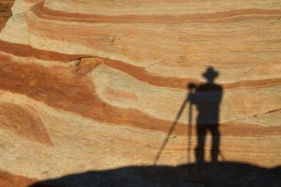 The Shadow of a Photographer on an Eroded Sandstone Formation