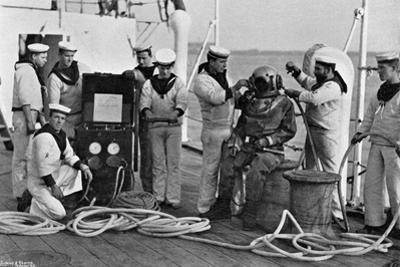 Diver and His Apparatus on Board HMS Blake, 1896 by Gregory & Co