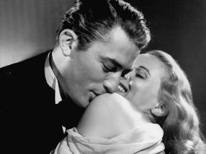 """Gregory Peck Embracing Ann Todd in Publicity Still for Alfred Hitchcock's Film """"The Paradine Case."""""""