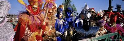 https://imgc.allpostersimages.com/img/posters/group-of-people-in-masks-and-costume-carnival-venice-veneto-italy-europe_u-L-P2R3WE0.jpg?p=0