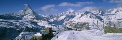 Group of People Skiing Near a Mountain, Matterhorn, Switzerland