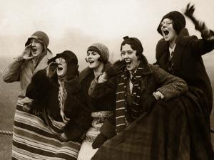 Group of Women Spectators Cheering, Wrapped in Blankets