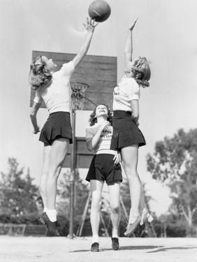 Group of Young Woman Playing Basketball