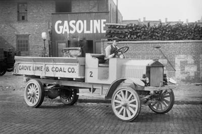 Grove Lime and Coal Company in Front of a Building Sign That Reads Gasoline