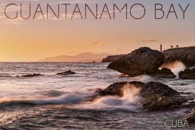 https://imgc.allpostersimages.com/img/posters/guantanamo-bay-cuba-golden-pink-sky-and-ocean_u-L-Q1GQMTK0.jpg?p=0