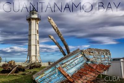 https://imgc.allpostersimages.com/img/posters/guantanamo-bay-cuba-lighthouse-and-broken-ship_u-L-Q1GQMT10.jpg?p=0