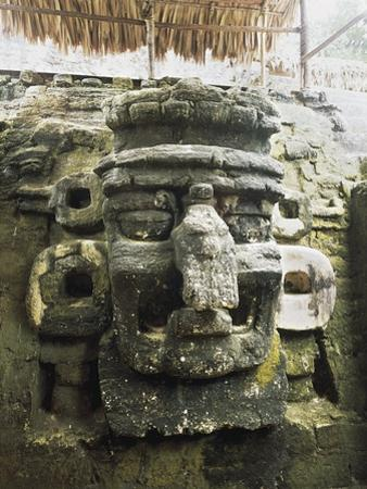 Guatemala, El Peten, Tikal National Park, Mask of Chac, God of Rain at Archaeological Site