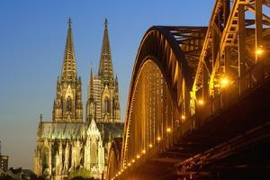 Cologne Cathedral and Hohenzollern Bridge on Rhine River by Guido Cozzi