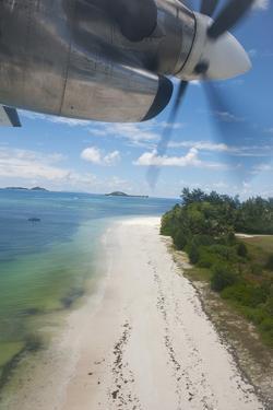 Propeller Plane Landing on Praslin Island, Seychelles, Indian Ocean Islands by Guido Cozzi