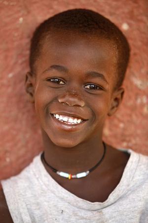 https://imgc.allpostersimages.com/img/posters/guinean-child-douggar-thies-senegal_u-L-Q1GYK1I0.jpg?artPerspective=n