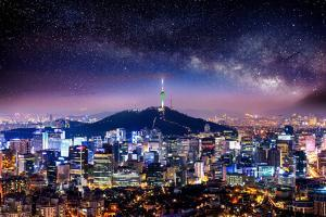View of Downtown Cityscape and Seoul Tower with Milky Way in Seoul, South Korea. by Guitar photographer