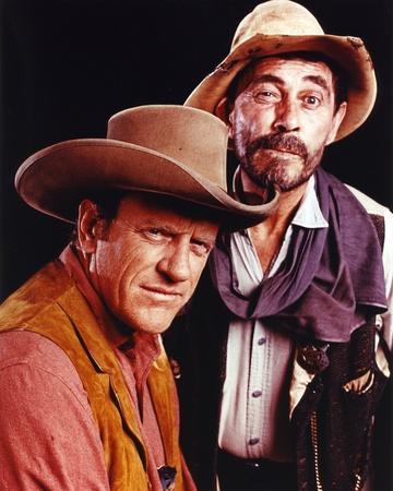 https://imgc.allpostersimages.com/img/posters/gunsmoke-two-cowboy-outfit-portrait_u-L-Q1157GQ0.jpg?artPerspective=n