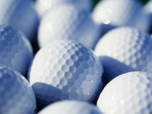 Close-up of Golf Balls by Guy Crittenden