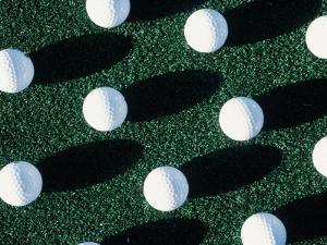 Golf Balls on Grass by Guy Crittenden