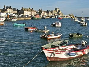Harbour and Fishing Boats With Houses and Church in the Background, Barfleur, Normandy, France by Guy Thouvenin