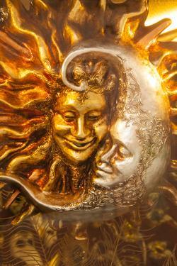 Moon and Sun Carnival Mask Decorations, Venice, Veneto, Italy, Europe by Guy Thouvenin