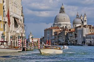 Taxi and Boat on Grand Canal with Palace Facades and Salute Church Domes by Guy Thouvenin