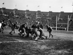 American Football Game, Running Back Heading Into Group of Blockers by H. Armstrong Roberts