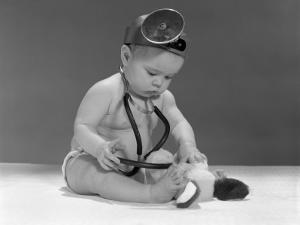 Baby Dressed in Diaper Stethoscope and Opthalmoscope by H. Armstrong Roberts