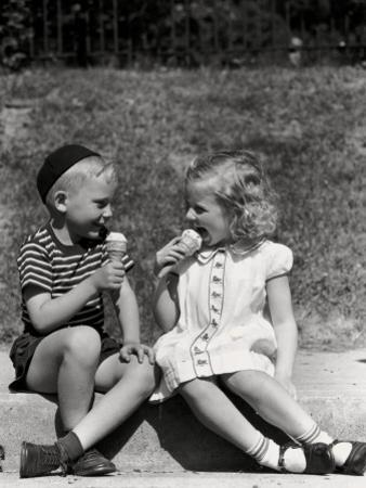 Boy and Girl Sitting on Curb, Eating Ice Cream Cones by H. Armstrong Roberts