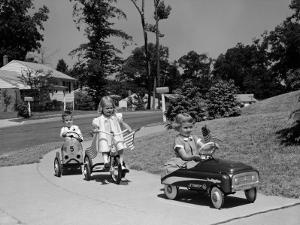 Boy and Two Girls on Suburban Sidewalk, Riding Tricycle and Toy Cars by H. Armstrong Roberts