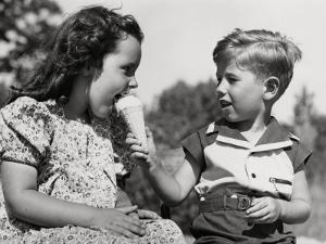 Boy Letting Girl Lick His Ice-Cream Cone by H. Armstrong Roberts