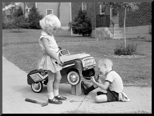 Children on Suburban Sidewalk, Boy Playing As Mechanic, Oiling Toy Pedal Car by H. Armstrong Roberts