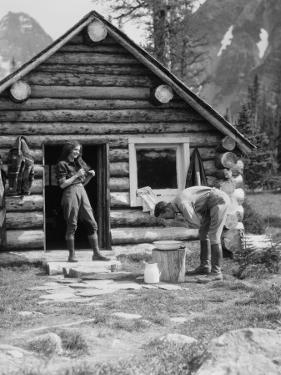 Couple at Log Cabin by H. Armstrong Roberts